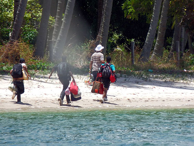 Robbers making their getaway after robbing 60 tourists on a catamaran in the sea off Carneiros Beach, near Tamandare, south coast of Pernambuco, Brazil