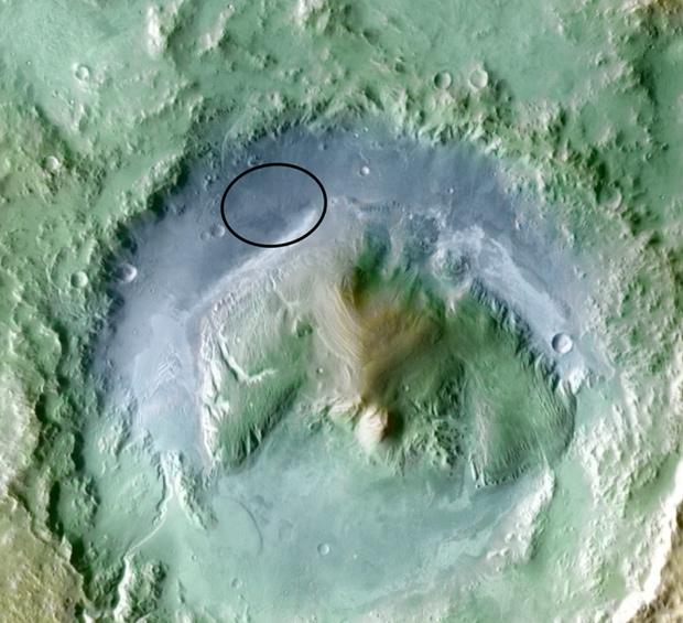 Local do pouso é mostrado na parte superior da imagem, marcado por uma elipse. A diferença entre a região mais baixa da cratera e o pico dos montes ao redor é de até 5 quilômetros. (Foto: JPL-Caltech / Nasa / Divulgação / via Reuters)