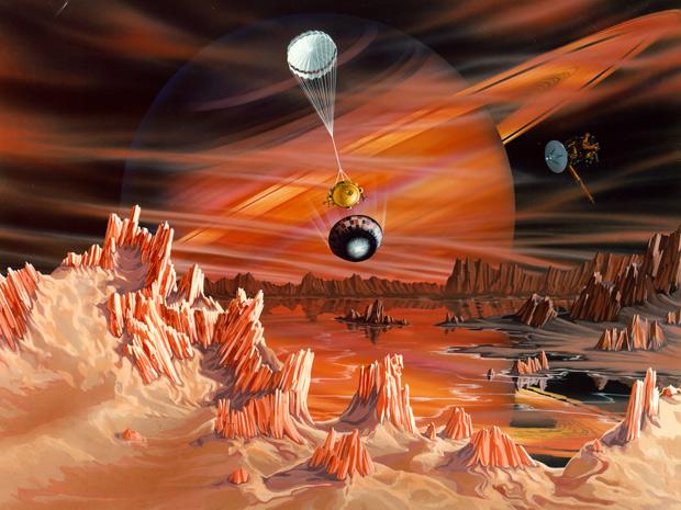O satélite Titã é representado artisticamente, recebendo uma sonda. (Foto: Craig Attebery / JPL)