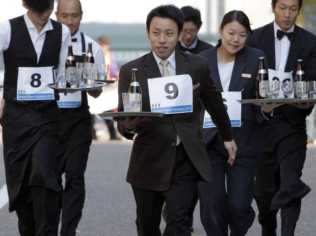 Garçons disputaram corrida na quarta-feira. (Foto: Itsuo Inouye/AP)