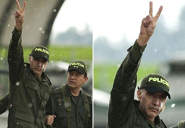 Alberto Erazo cumprimentou as pessoas que aguardam sua chegada no aeroporto de Bogotá (Foto: Luis Acosta/AFP)