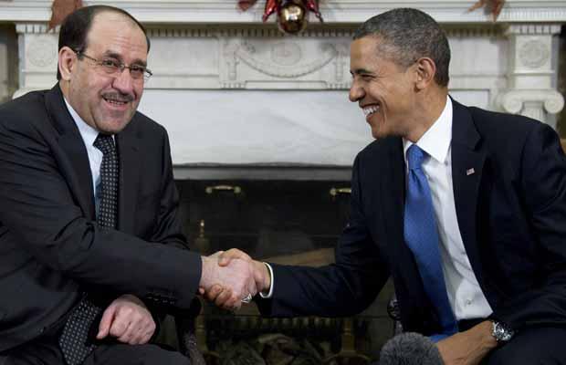 O premiê do Iraque, Nuri al Maliki, e o presidente dos EUA, Barack Obama, durante encontro nesta segunda-feira (12) na Casa Branca (Foto: AP)