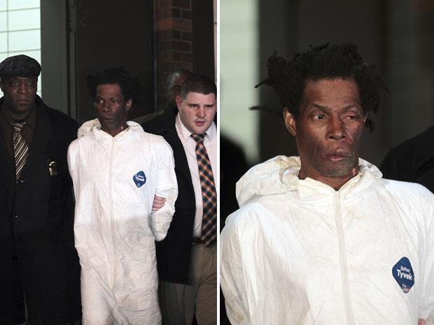 Jerome Isaac, de 47 anos, é levado por policiais (Foto: AP)