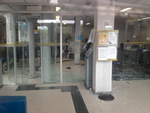 Broken windows at a bank branch in Baixa Grande, Bahia, Brazil which was robbed by a criminal gang who sang Happy Birthday song as they fled with an undisclosed amount of cash.