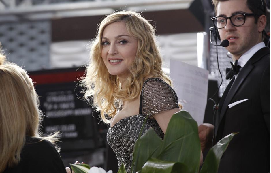 Madonna chegou de última hora para a premiação e ganhou rapidamente o prêmio de melhor canção original com 'Masterpiece', música do filme 'W.E.', dirigido por ela