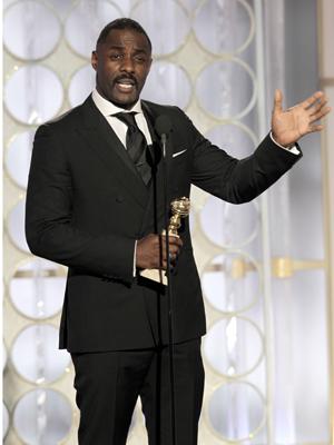 """Idris Elba, vencedor de melhor ator em minissérie ou filme para a TV por """"Luther"""" (2010) (Foto: AP)"""