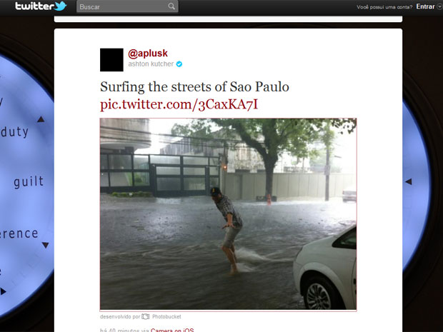Ashton Kutcher surfing flooded Sao Paulo street