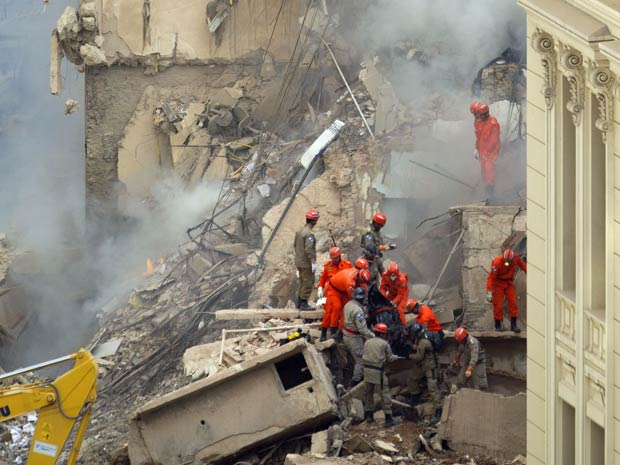 Rescue workers search for dead and missing in Rio de Janeiro highrise building collapse 25 January 2012