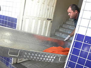 Charred body is removed from a pizzeria oven in Cuiaba.