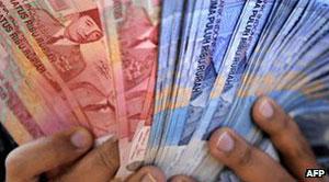 Dinheiro indonésio (Foto: AFP)