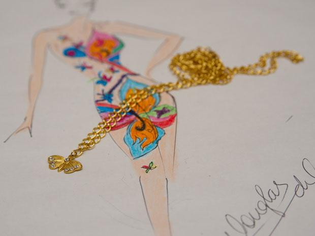 Desenho da pintura e a peça criada para ser usada por Mulher Pêra (Foto: Flavio Moraes/G1)