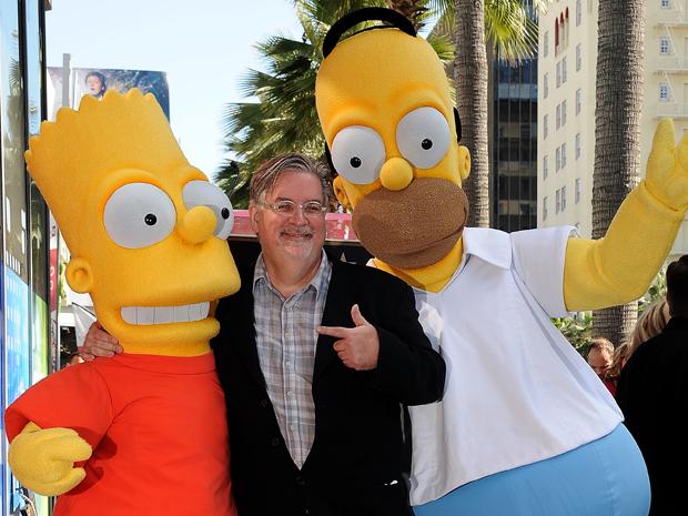 O criador dos Simpsons, Matt Groening posa entre os personagens Bart Simpson, à esquerda, e Homer Simpson (Foto: Reuters)