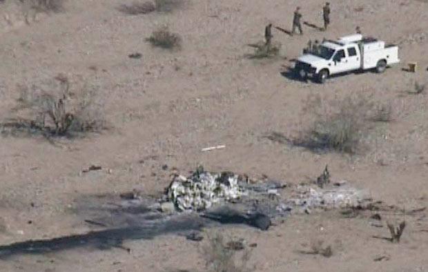 Imagem de TV local divulgadas na noite de quinta-feira (23) mostra destroços no local do acidente (Foto: AP)