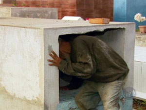 Cristiano Jose Silva, 61, lives in the Tres Pontas cemetery, sleeping in tombs