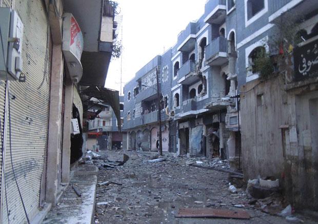Destruição na cidade de Homs (Foto: Reuters//Zaman Al Wasel)