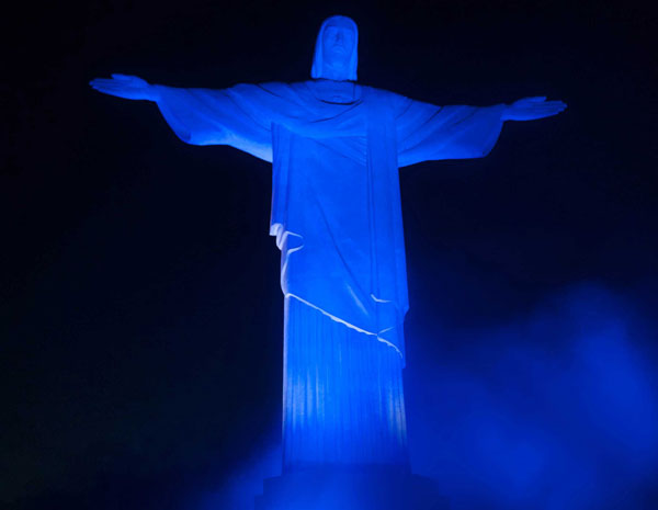 Christ the Redeemer statue on top of Corcovado is lit up blue to symbolyse Autism, on April 2nd, 2012, World Autism Day of Awareness.