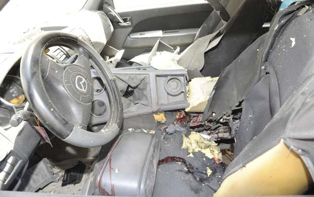Interior do carro-bomba que explodiu nesta terça-feira (24) em Damasco, capital da Síria (Foto: Sana/Reuters)