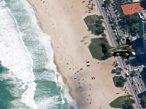 Jetman flies over Copacabana Beach near the iconic Copacabana Palace Hotel in Rio de Janeiro on Wednesday 02 May 2012