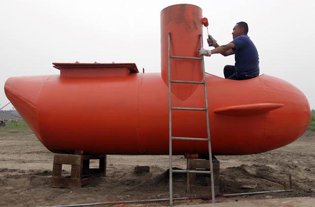 No ano passado, agricultor vendeu submarino por 100 mil yuans (R$ 30,7 mil).  (Foto: Reuters)