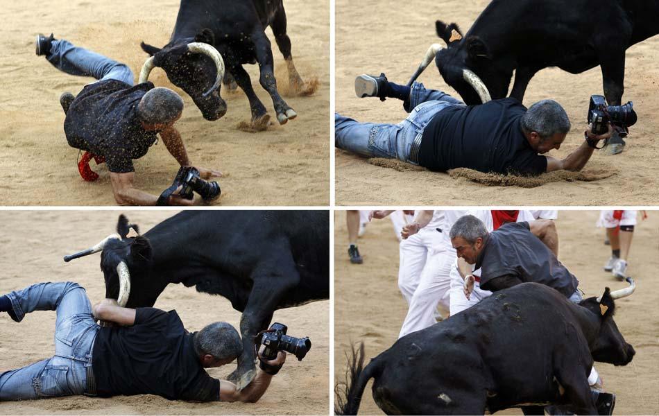 12 de julho - O fotógrafo Joseba Etxaburu, da agência Reuters, é atacado por uma vaca na arena de Pamplona após o 6º dia de corridas de touros de São Firmino