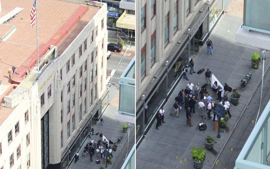 Policiais examinam um corpo em frente ao Empire State
