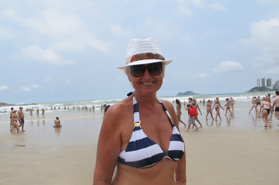 Turista que curte a praia de Guarujá 1108be498ff