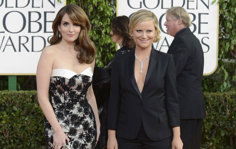 As apresentadoras do Globo de Ouro 2013, Amy Poehler, ambas ex-integrantes do programa humorístico 'Saturday night live