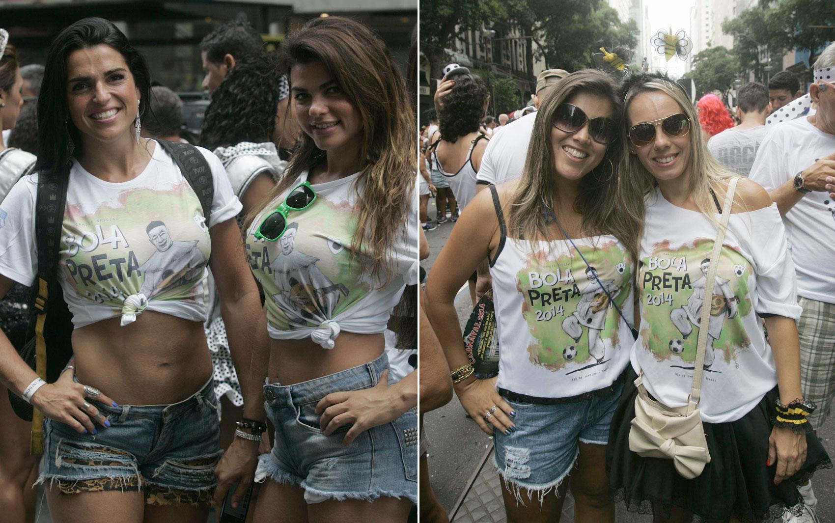 Foliãs mostram o corpo sarado durante a passagem do bloco Cordão da Bola Preta, neste sábado (1), no Rio