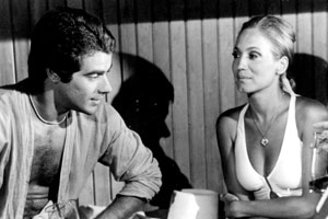 Dino (Mário Gomes) se envolve com Cláudia (Susana Vieira) (Foto: CEDOC/ TV Globo)