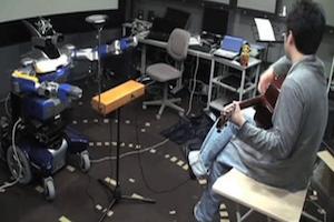 Robô toca música (Foto: Reprodução)