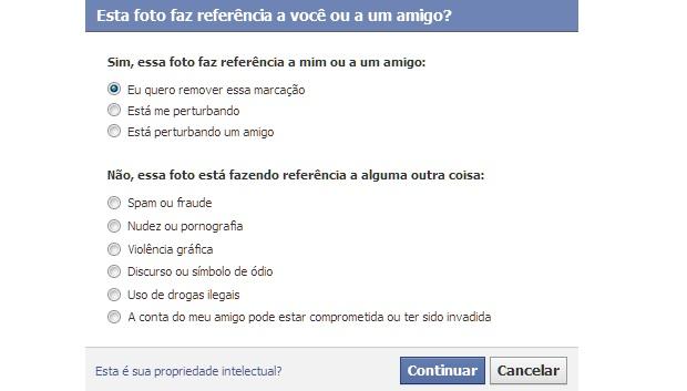 Opções para relatar problemas em uma foto publicada no Facebook