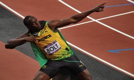 Usain Bolt celebra a vitória (Foto: Dan Chung/The Guardian)