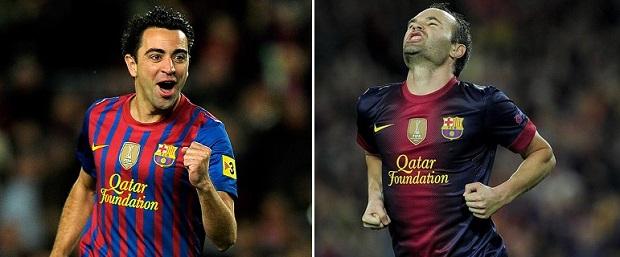 Xavi e Iniesa são destaques na vida real e no Fifa (Foto: Reprodução/AFP)