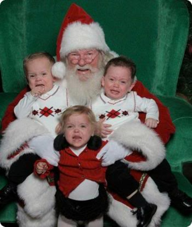 Irmãos choram ao tirar foto com papai noel (Foto: Reprodução)