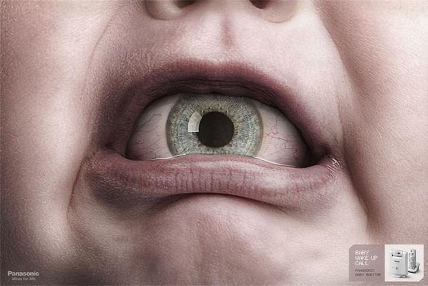 Um olho na boca de um bebê em anúncio para os pais (Foto: Reprodução)