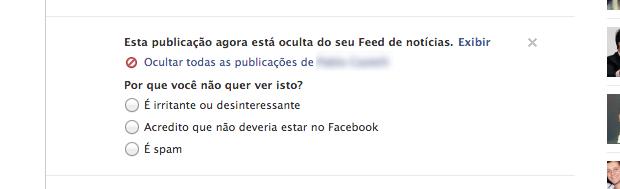 Denunciando publicação como spam (Foto: Reprodução/Helito Bijora)