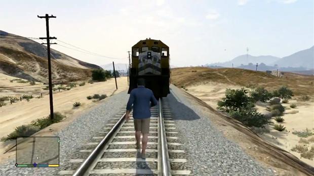 Michael resolve competir com um trem para ver quem desvia primeiro em GTA 5 (Foto: Reprodução)