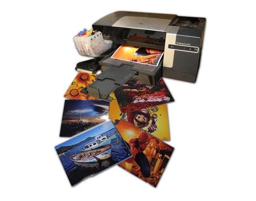 Imprimindo fotos em papel fotográfico (Foto: Reprodução/guterink.)