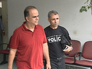 Marcos Valério deixa delegacia em Belo Horizonte, de onde segue para o IML. (Foto: Reprodução/TV Globo)