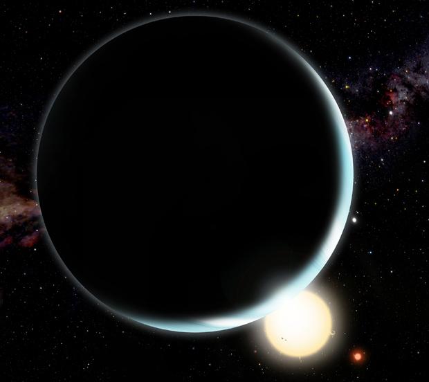 Ilustração mostra como seria o planeta Kepler 16b, com dois sóis ao fundo. (Foto: David A. Aguilar / Centro de Astronomia Harvard-Smithsonian)