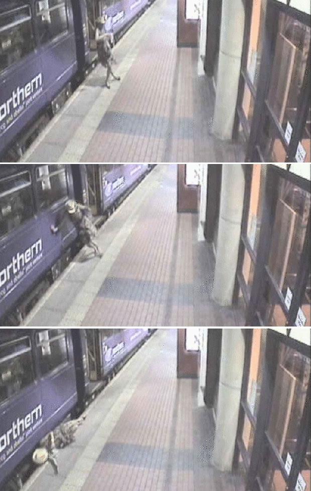Mulher foi filmada tropeçando e pondo em risco a própria vida (Foto: British Transport Police/BBC)