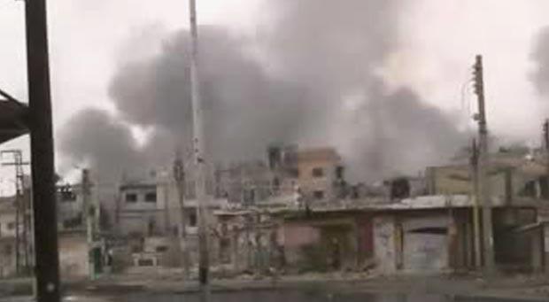 Bairro de Baba Amr, em Homs, sob ataque das forças do governo em 26 de feveiro; a imagem foi divulgada pela oposição (Foto: AFP)
